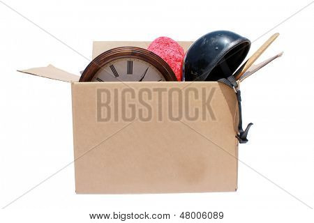 A Genuine Box of used items ready for a garage sale, Yard Sale, Auction, or donation to a charitable organization. One man's junk is another man's treasure! Isolated on white with room for your text