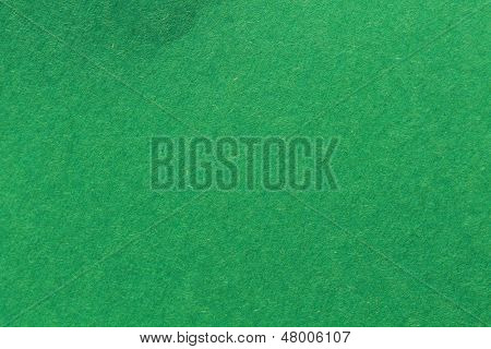 close up aka macro shot of green construction paper, showing texture, paper fibers, flaws, and more. the perfect image for all your colored construction or recycled paper needs