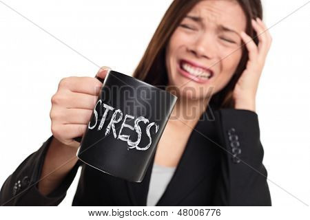 Stress at work concept. Business woman stressed being to busy. Businesswoman in suit holding head drinking coffee creating more stress. Mixed race Asian Caucasian female isolated on white background.