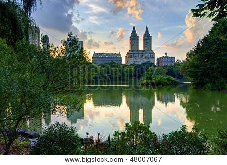 Upper West Side skyline from Central Park Lake in New York City.