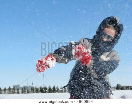 Child In Sunglasses Throws Snow