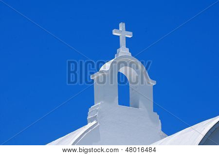 White cross on top of church