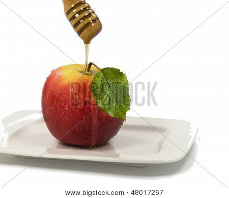 Apple and honey on white background