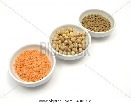 Three Bowls Of Chinaware With Garbanzos Lentils And Red Lentils