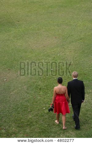 Young Couple In Formal Attire Walking Away