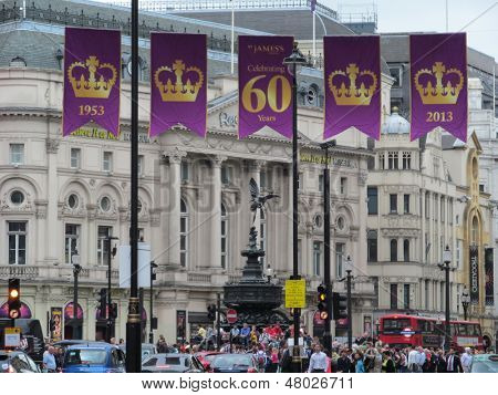 LONDON - JULY 8: Banners are flying above Piccadilly circus, London, to celebrate englands, Queen Elizabeth 60year reign, from 1953 to 2013. London, July 8, 2013.