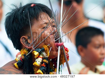 PHUKET, THAILAND- OCT 23: Unidentified participant of parade on October 23, 2012 Vegetarian Festival Phuket Thailand. The Festival is a famous annual festival also known as Nine Emperor Gods festival
