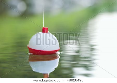 Bobber Floating In On Water With Ripples