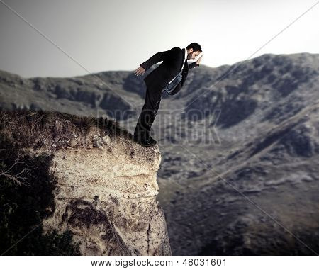 Young Businessman Falls From The Cliff