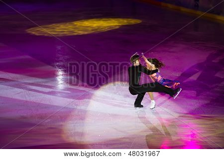 MOSCOW - DEC 14: Beautiful pair perform at Young sportives display an iceskating shot at Ice Palace Mechta on December 14, 2012 in Moscow, Russia.