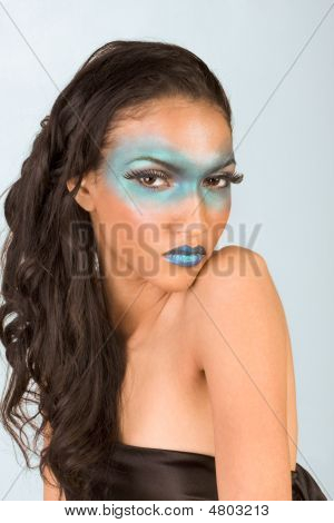 Mixed Race Woman Wearing Exotic Blue Make Up
