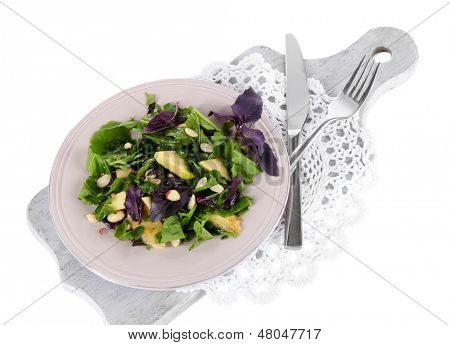 Light salad on plate isolated on white