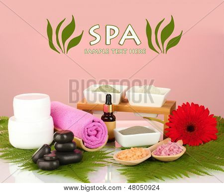Cosmetic clay for spa treatments on colorful background