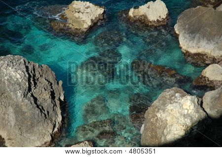 Rocks And Sea Water.