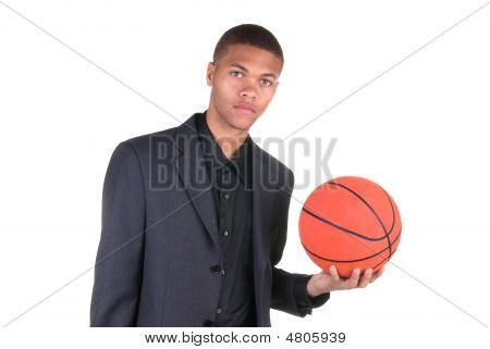 African American Holding Basketball