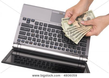 Counting Cash On Laptop