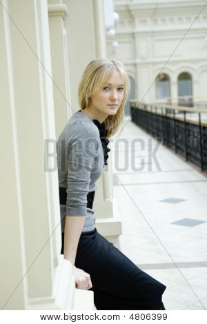 Young Attractive Serious Girl At Wall In Museum