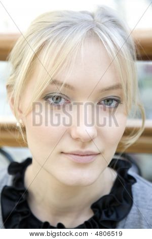 Portrait Blond Woman With Blue Eyes