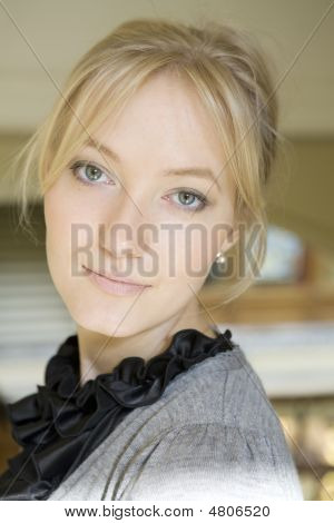 Portrait Attractive  Blond Woman With Blue Eyes