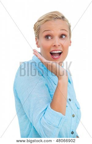 Astonished blonde woman on white background