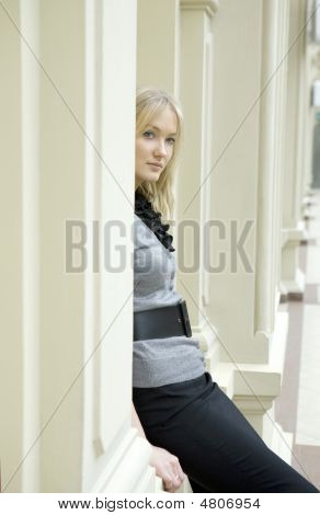 Young Attractive Blond Woman Standing At Railing In State Department Store. Moscow. Shopping