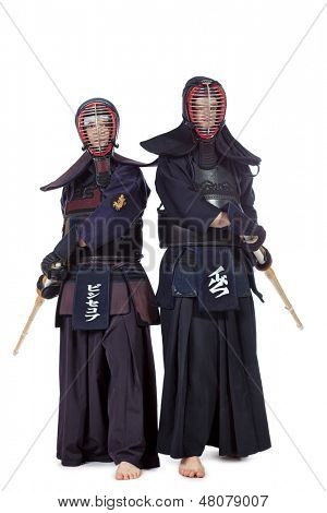 Two kendo fighters posing together over white background. Asian martial arts.