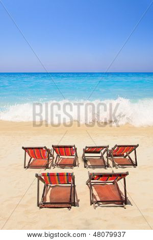 Paradisiac beach with chairs in Greece