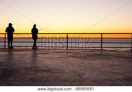 Pier fishing at sunset