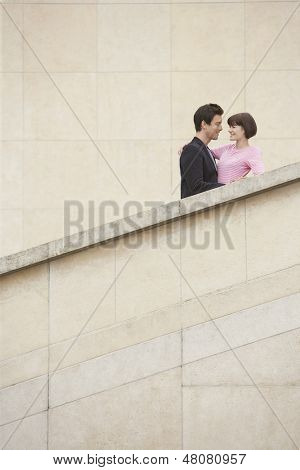 Low angle view of a young couple embracing on stairway