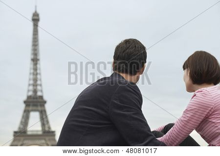 Rear view of a couple looking at Eiffel Tower