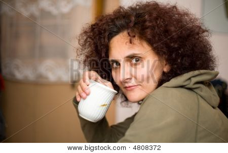 Redhead Woman Drinking Coffee