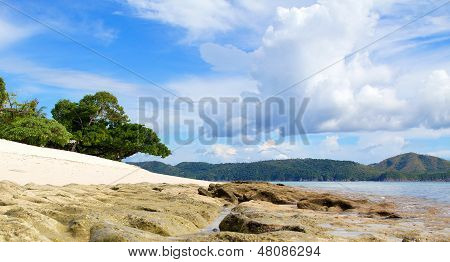 Tropical Beach with clouds and sky