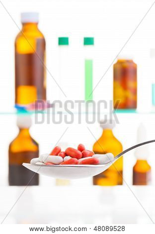 Spoon With White And Yellow Pills