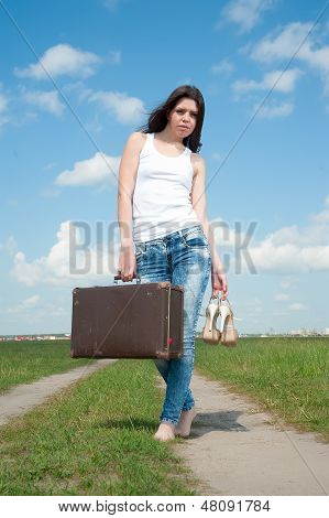 Pretty woman with old suitcase
