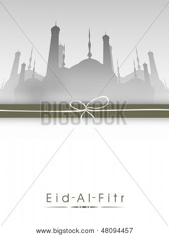 Greeting card, gift card or background with silhouette of mosque on occasion of muslim community festival Eid Al Fitr (Eid Mubarak).