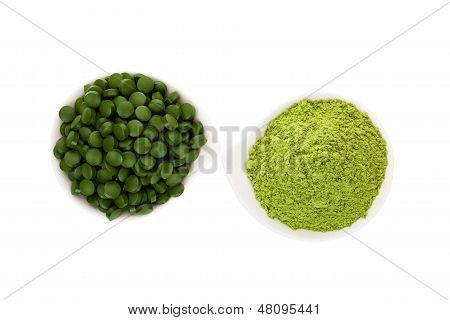 Healthy Living. Spirulina Pills And Wheatgrass.