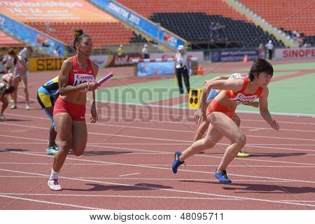 DONETSK, UKRAINE - JULY 13: Chyna Ries of USA (left) and Xuan Wang of China compete in the medley relay competitions during World Youth Championships in Donetsk, Ukraine on July 13, 2013