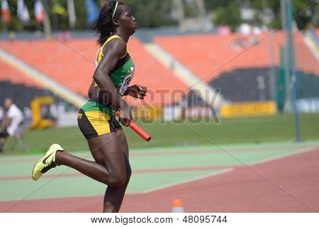 DONETSK, UKRAINE - JULY 13: Tiffany James of Jamaica competes in the medley relay competitions during World Youth Championships in Donetsk, Ukraine on July 13, 2013