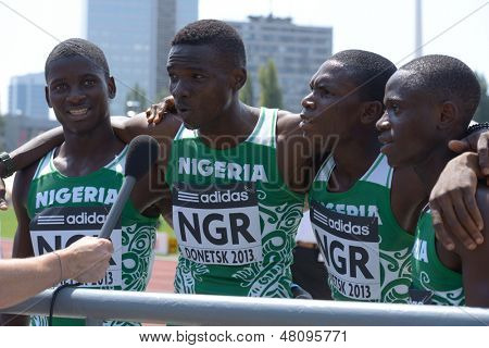 DONETSK, UKRAINE - JULY 13: Team Nigeria in the boys medley relay give an interview during 8th World Youth Championships in Donetsk, Ukraine on July 13, 2013