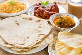 stock photo of curry chicken  - Chapatti roti or Flat bread - JPG