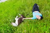 pic of pitbull  - Young happy woman playing on the grass with her dog - JPG
