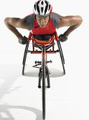 picture of paralympics  - Portrait of a confident paraplegic cycler against white background - JPG