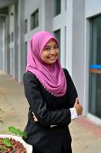 picture of muslimah  - Young asian muslim woman in head scarf smile - JPG