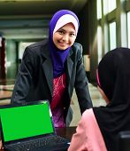 image of muslimah  - Young asian muslim woman in head scarf smile with confident pose - JPG