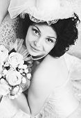 stock photo of glans  - Black and white portrait of young brunette bride with a bouquet - JPG