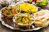 stock photo of curry chicken  - indian curries with rice and bread - JPG