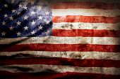 stock photo of patriot  - Closeup of grunge American flag - JPG