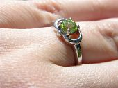 stock photo of peridot  - peridot ring close up on finger - JPG