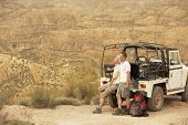 foto of four-wheel drive  - Middle aged couple in back of four - JPG