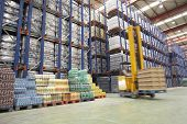 stock photo of forklift  - Blurred forklift driver warehouse - JPG